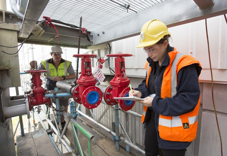 Staff check the equipment at a water treatment plant